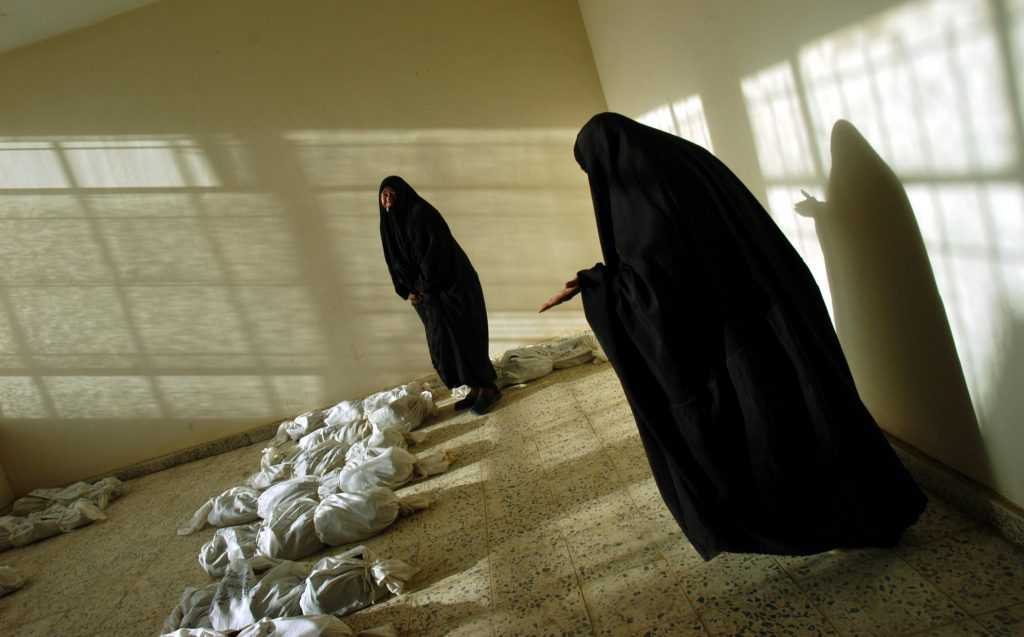 Women in Baghdad weep as they try to identify the remains of loved ones