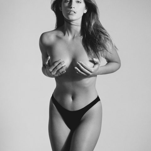 Cindy Crawford clutches her breasts in Herb Ritts' famous Playboy photo