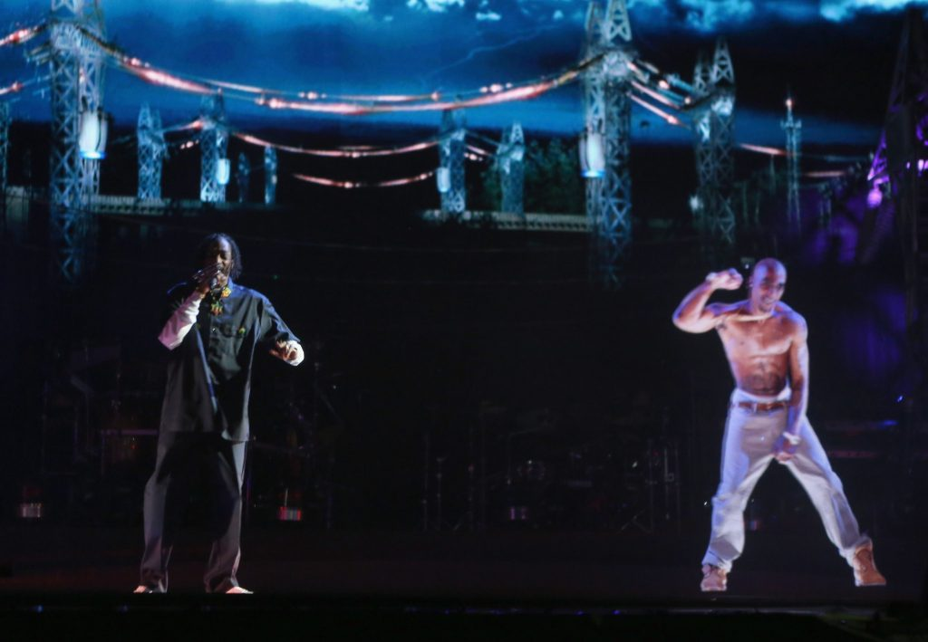 Snoop Dogg sings with a hologram of Tupac Shaur
