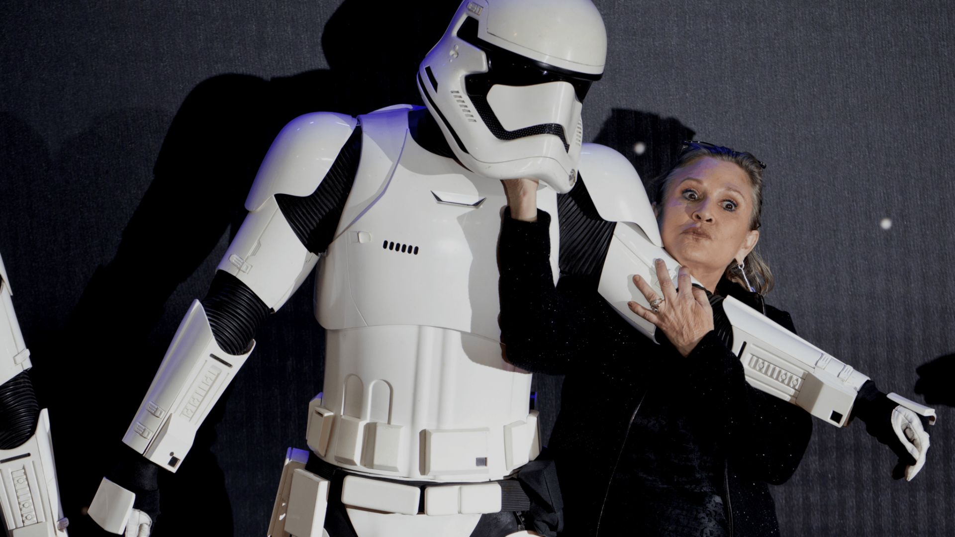 Carrie Fisher with a Stormtrooper at the UK premiere of Star Wars: The Force Awakens