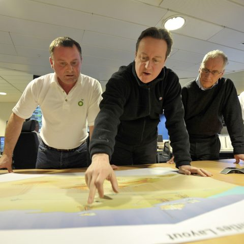 David Cameron looks at a map, possibly of Britain's porn league table