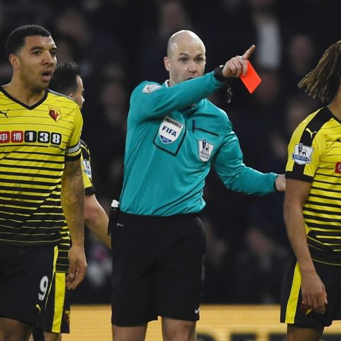 Watford's Nathan Ake is sent off by referee Anthony Taylor
