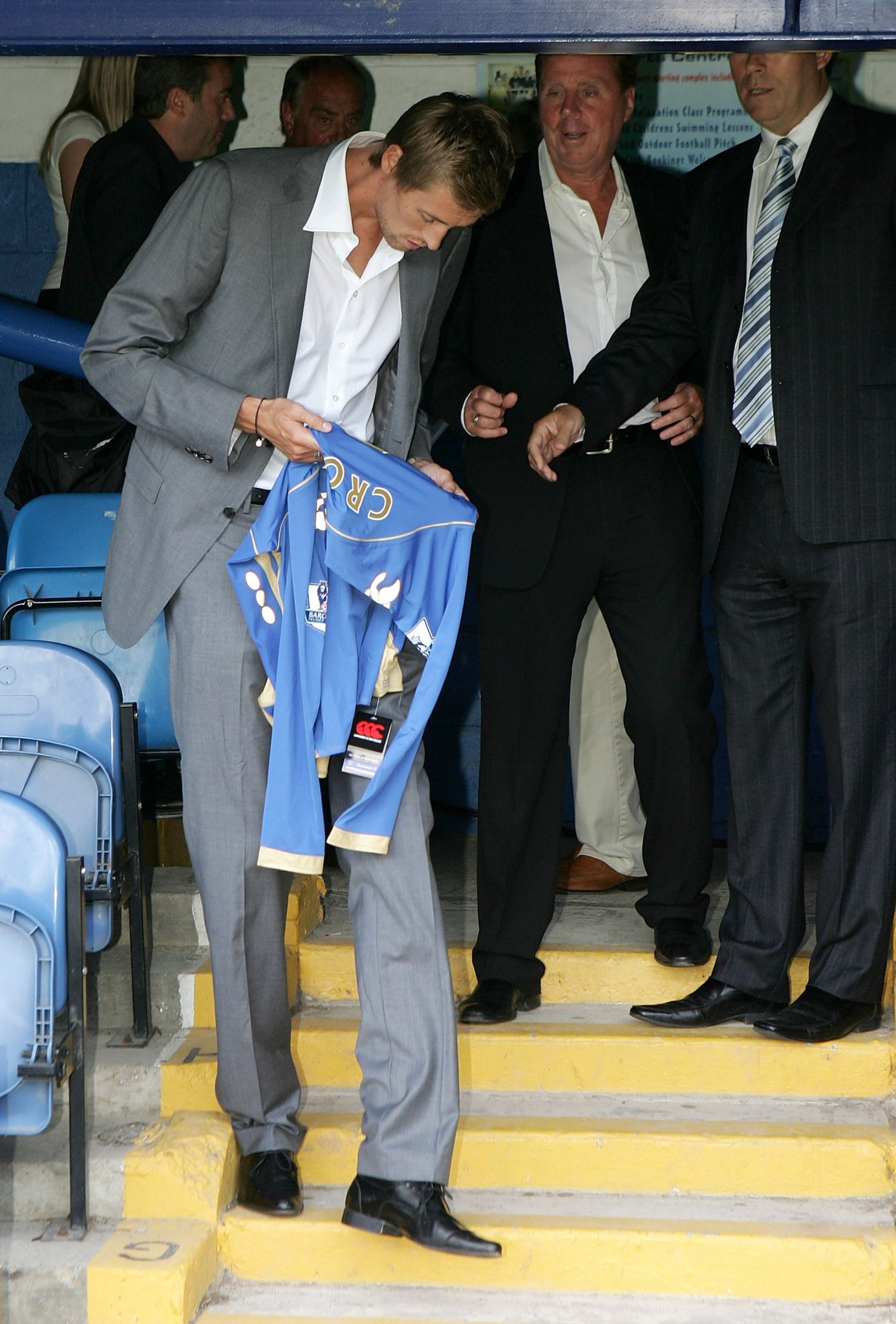 Harry Redknapp posing with Peter Crouch after signing the striker for Portsmouth.