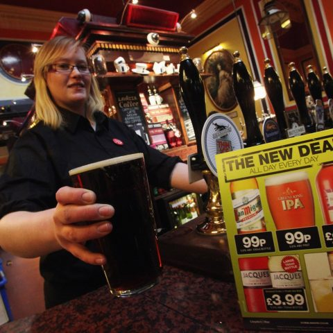 A Wetherspoons employee pulls a pint.