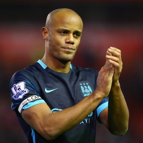 Vincent Kompany looks dejected after Manchester City lose to Liverpool in the Premier League.