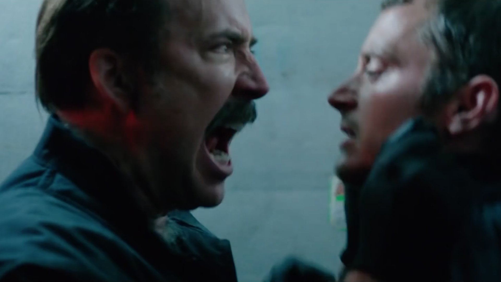 Nicolas Cage and Elijah Wood in The Trust