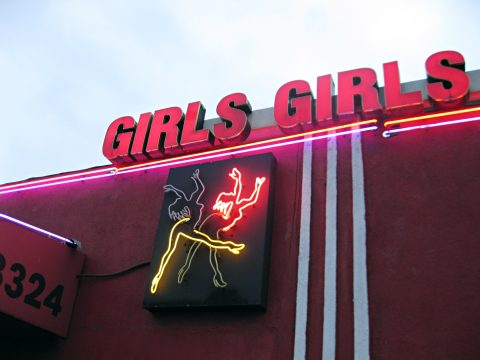 Strip club sign for Spearmint Rhino story