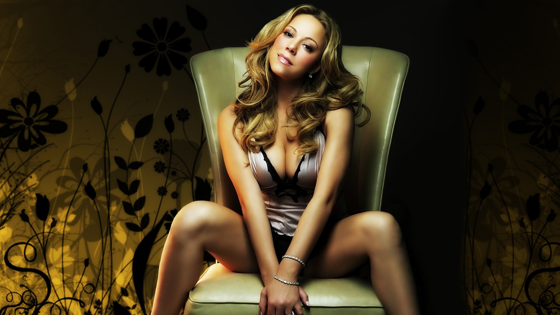 Mariah Carey posing on a chair.