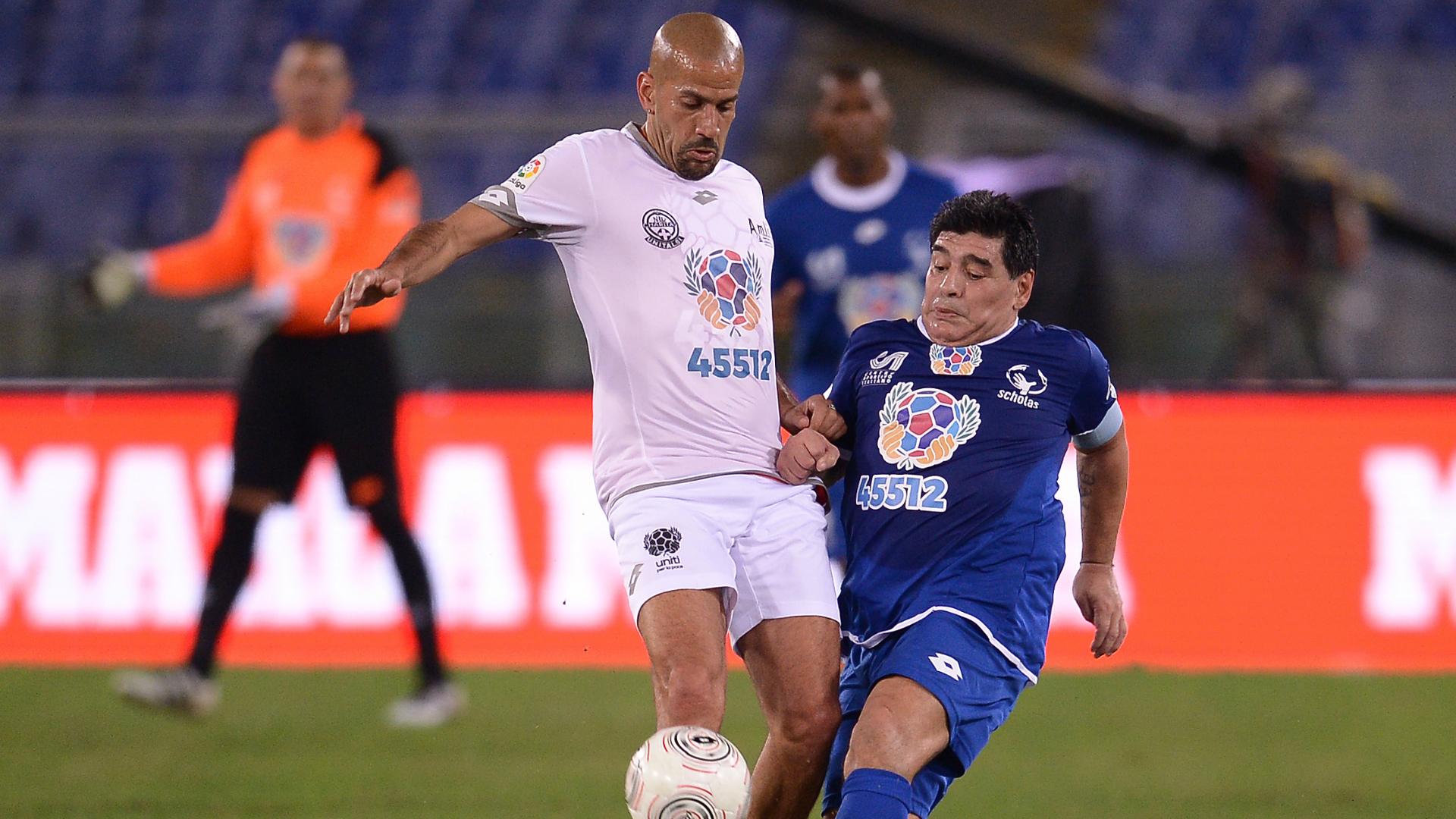 Juan Sebastian Veron and Diego Maradona playing in a charity game.