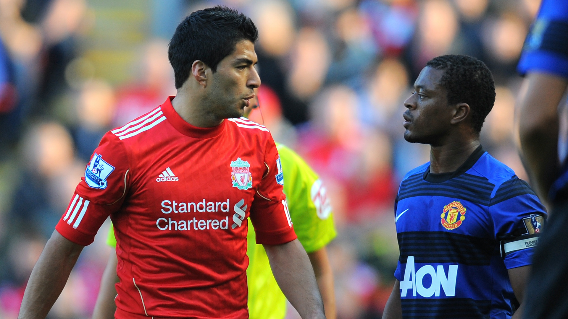 Luis Suarez and Patrice Evra playing for Liverpool and Manchester United respectively.