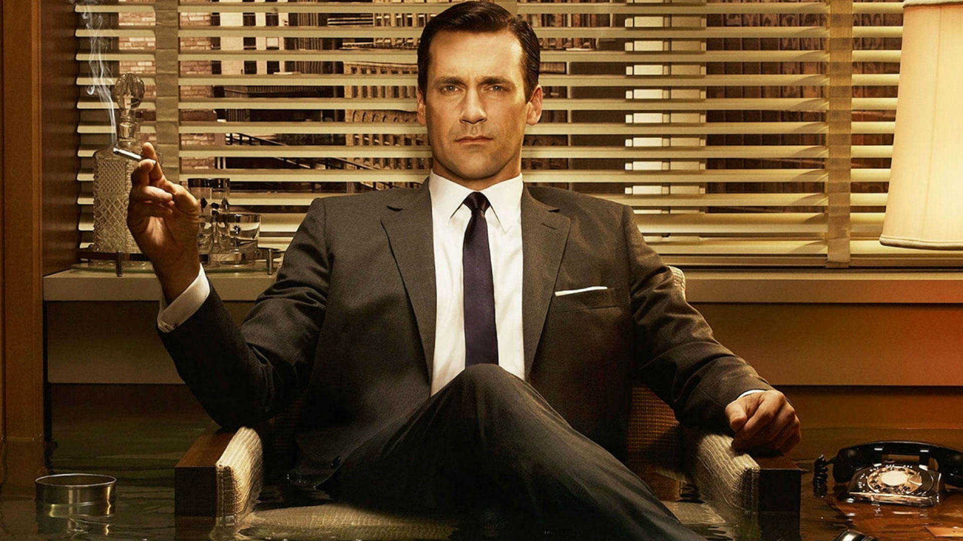 A suit wearing Jon Hamm as Don Draper in Mad Men