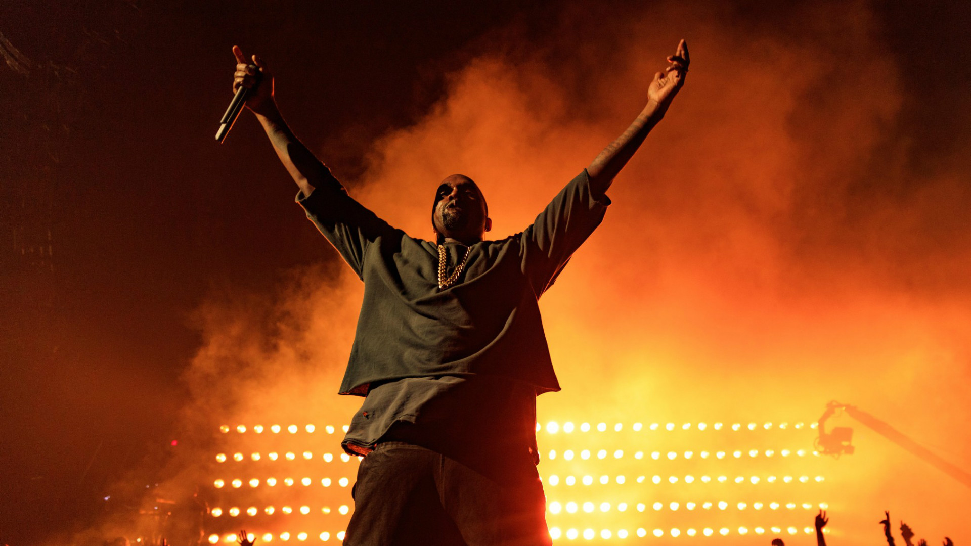 Kanye West performing on stage.