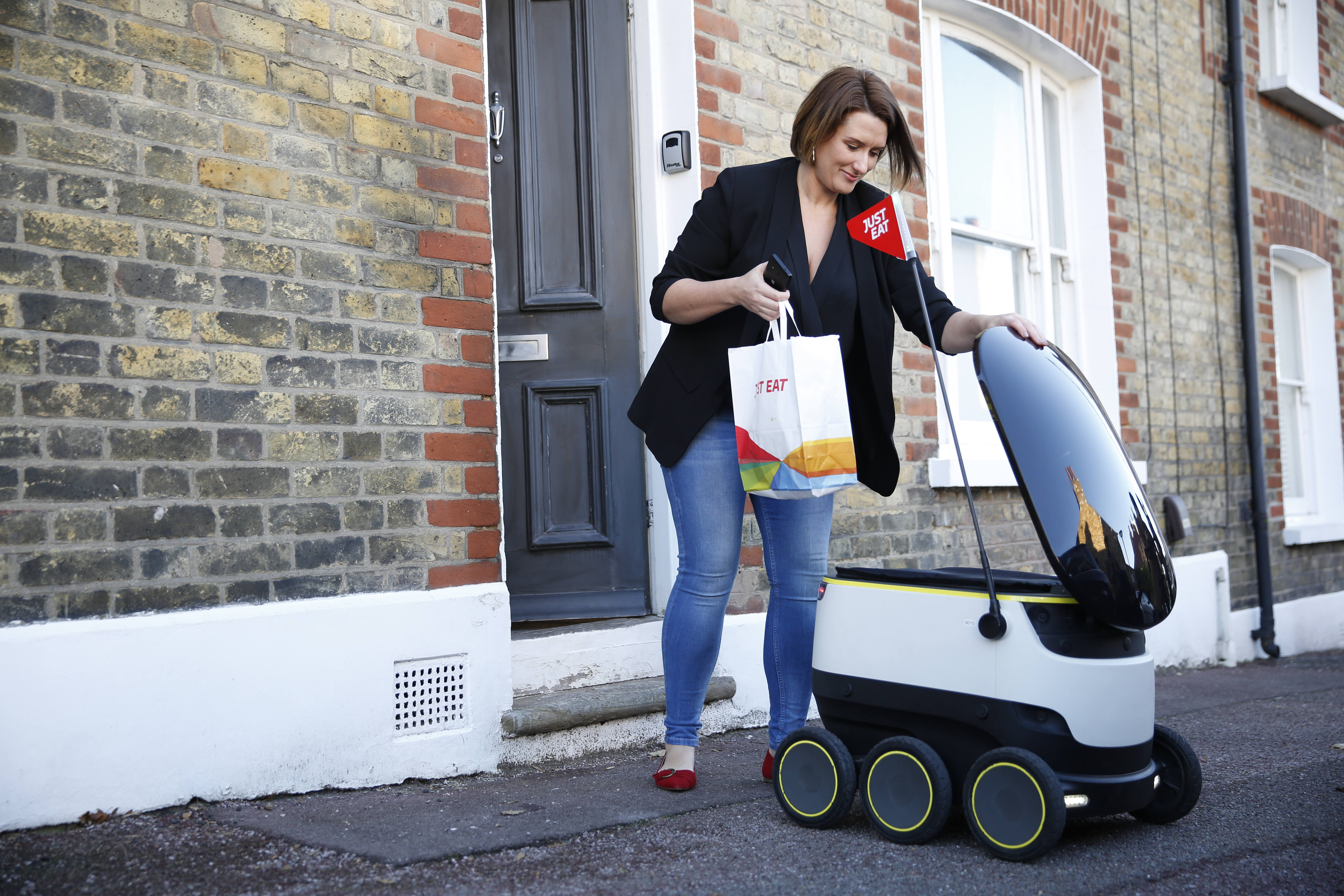 Just Eat, the world's largest online takeaway food company, and Starship Technologies have changed the face of home delivery by making the world's first online food delivery using a self-driving robot in Greenwich, South East London. After five months of exhaustive testing in the area, the first live delivery signals the next step in this revolutionary pilot program which will see local Just Eat customers receive automated robot deliveries in Greenwich. There are plans to expand the program across London in 2017.