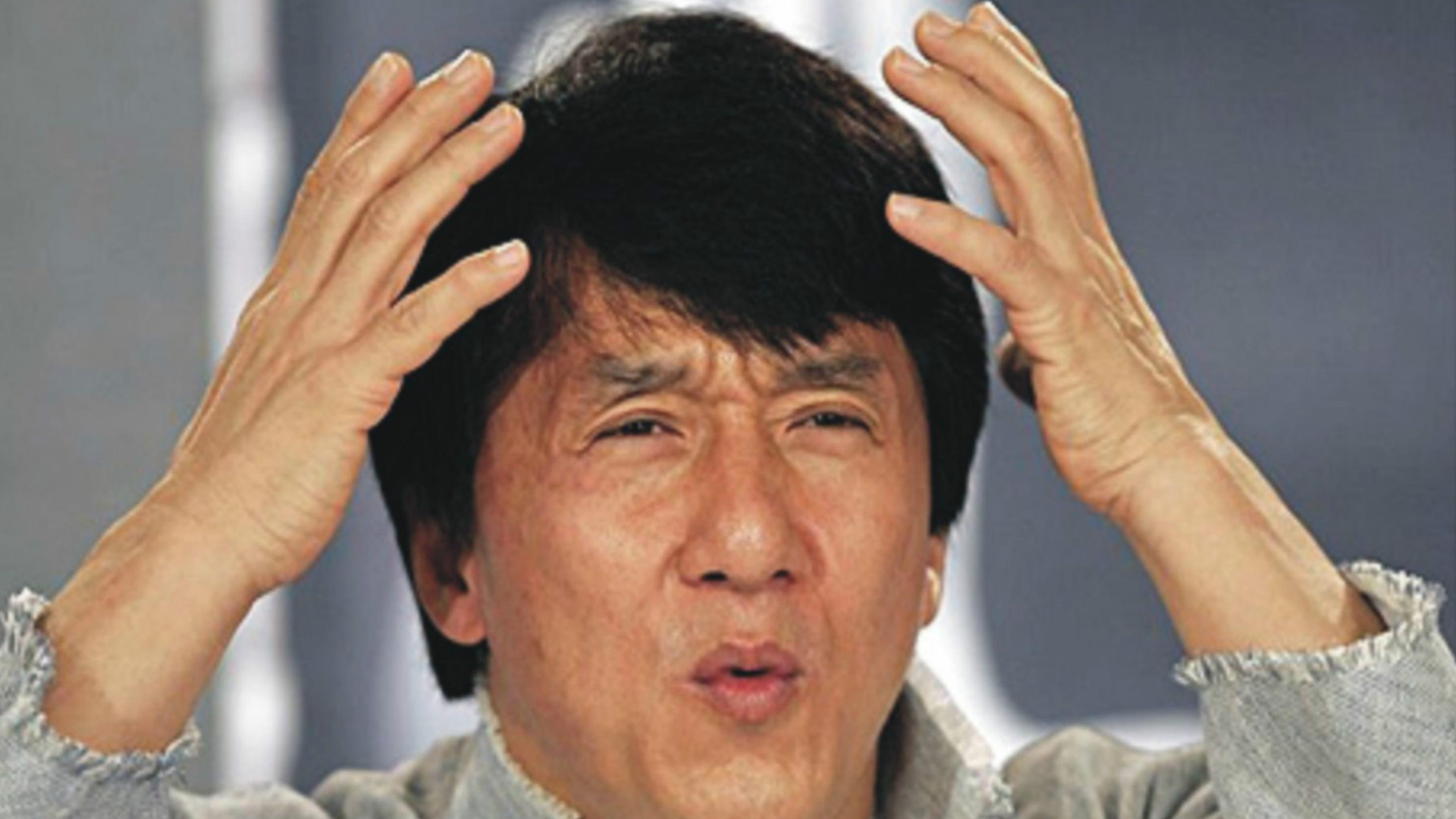 Jackie Chan looking very confused.