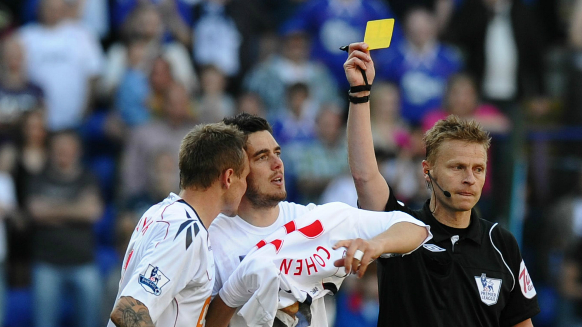 A player is booked for taking his shirt off.