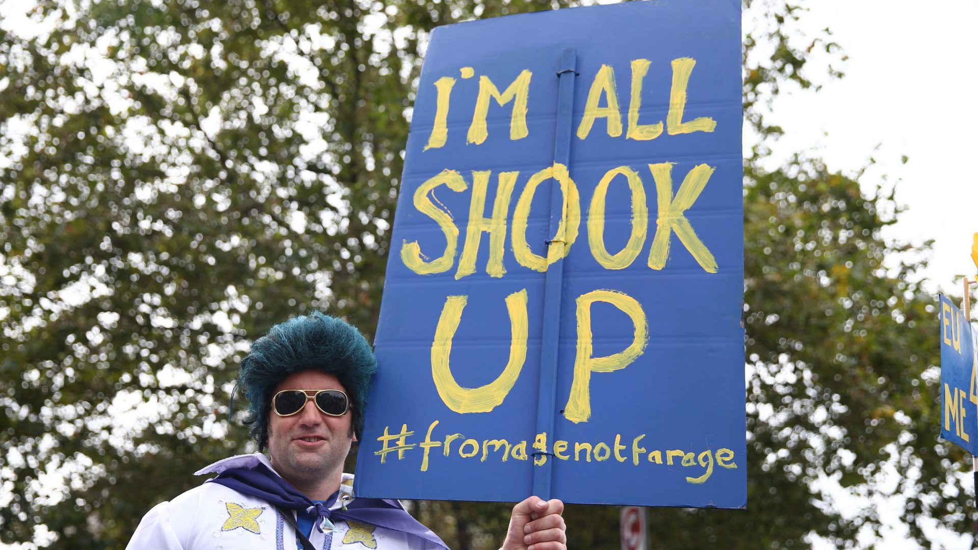 A man dressed as Elvis Presley stands with a pro-Europe placard as people gathered for a March for Europe protest to against the Brexit vote in London on September 3, 2016. Thousands marched in central London to Parliament Square in a pro-Europe rally against the referendum vote to leave the European Union.