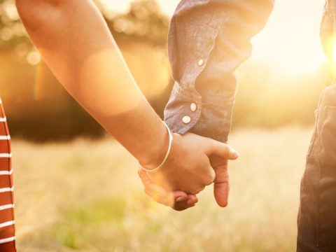 A picture of two people walking hand in hand