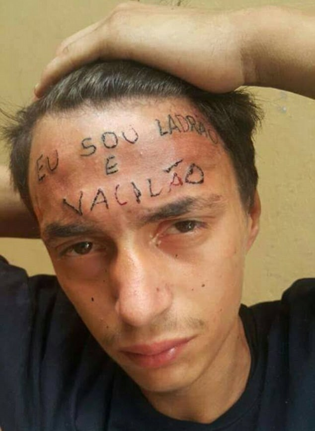 A boy with a tattoo on his forehead.