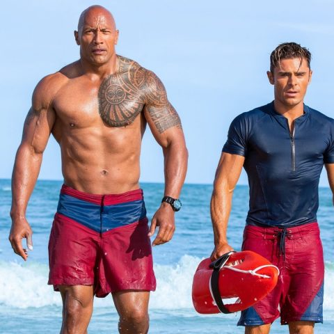 The Rock and Zac Efron in Baywatch.