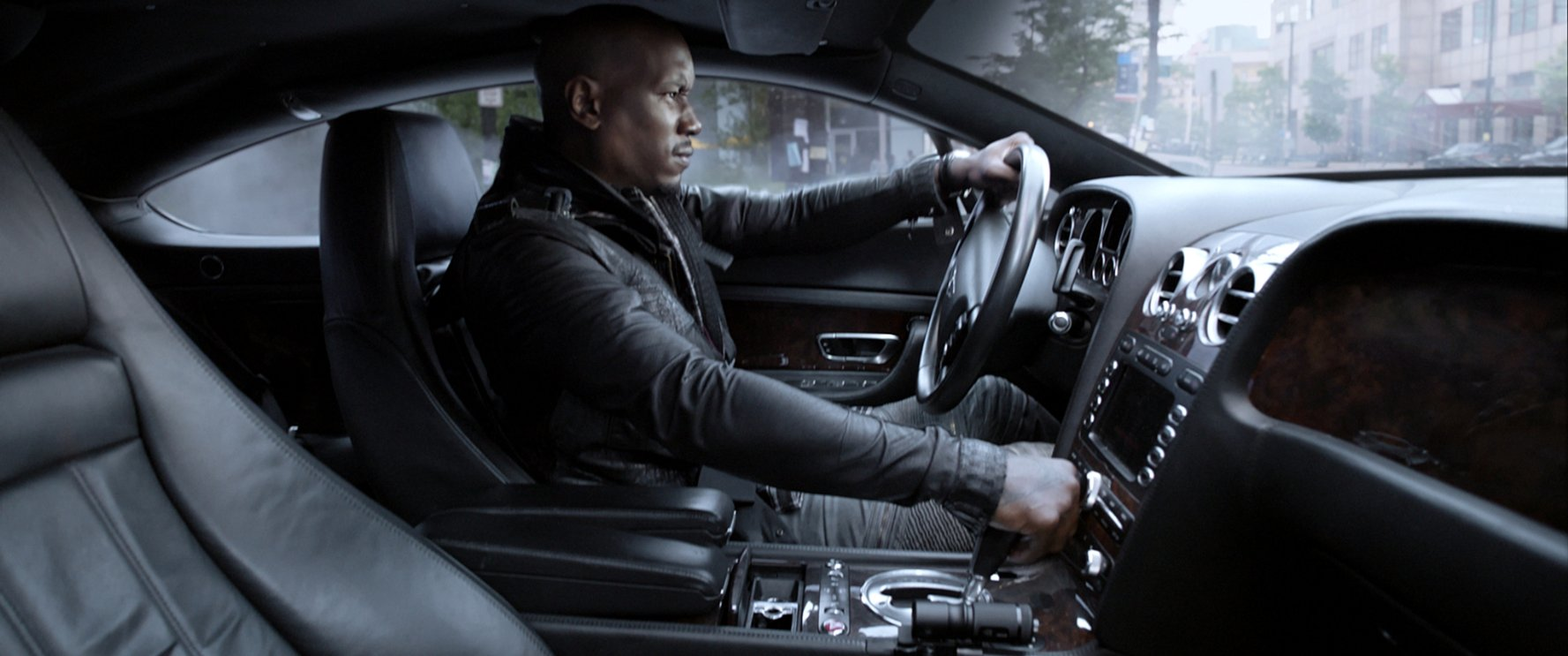Tyrese Gibson driving in Fast and Furious 8.