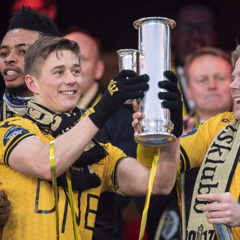 Lillestrom lift the trophy.