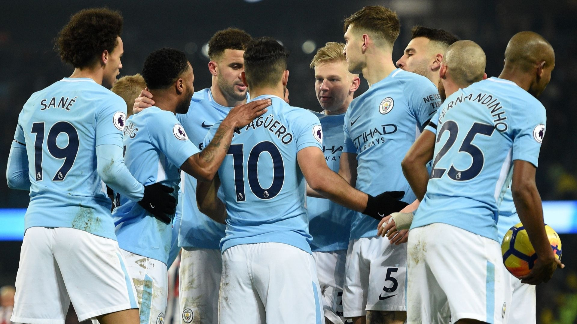 Sergio Aguero and his Manchester City teammates celebrate a goal.