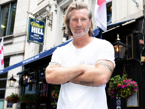 Robbie Savage outside the William Hill Pub.