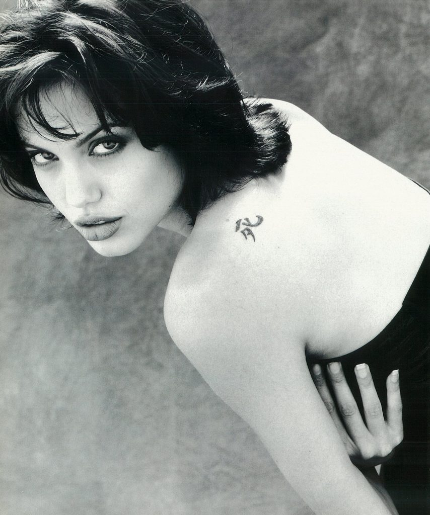 Angelina Jolie shows off one of her early tattoos