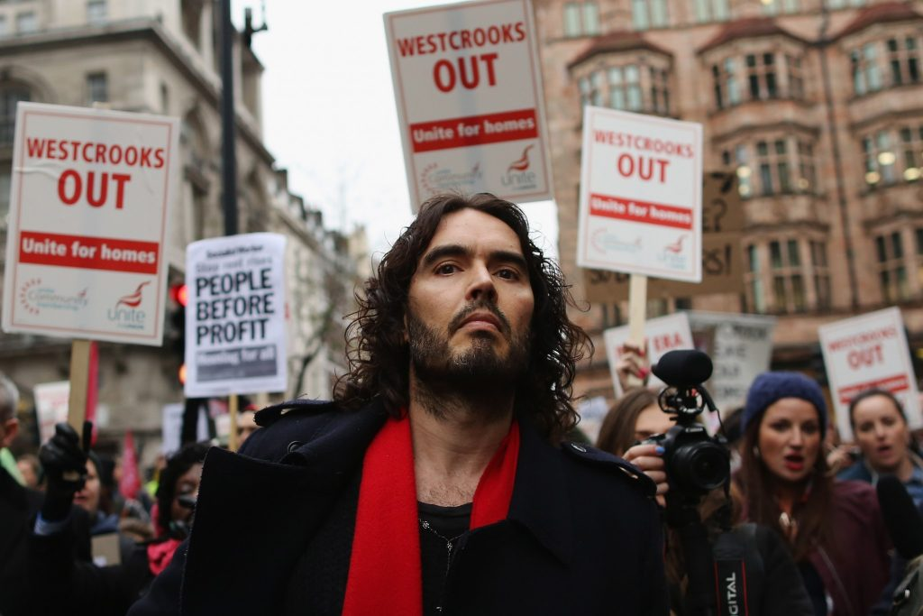 Russell Brand leads a housing protest in London