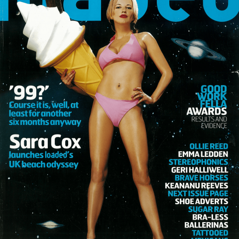 Sara Cox holding a '99 to represent the end of 1999 for Loaded