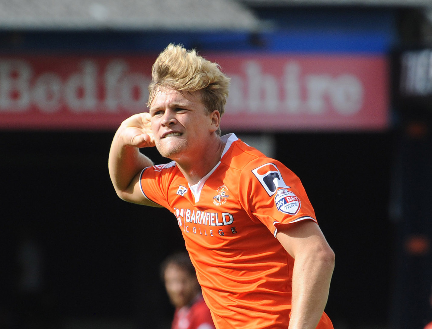 Luton Town midfielder Cameron McGeehan in action against Oxford