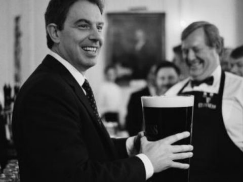 Tony Blair drinking a big Guinness