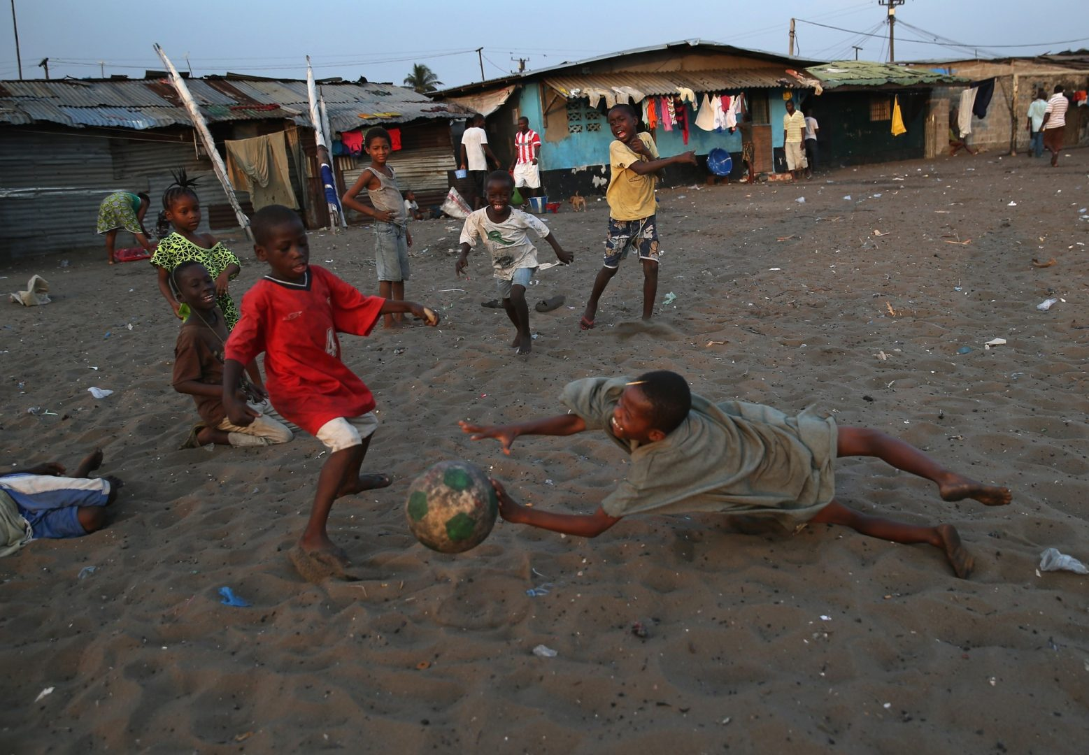 african kids play football in the townships