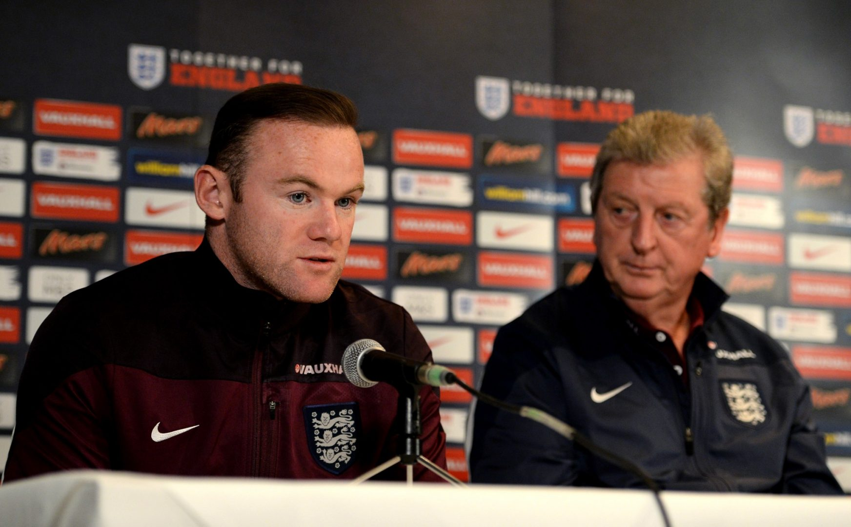 Wayne Rooney and Roy Hodgson at an England press conference.