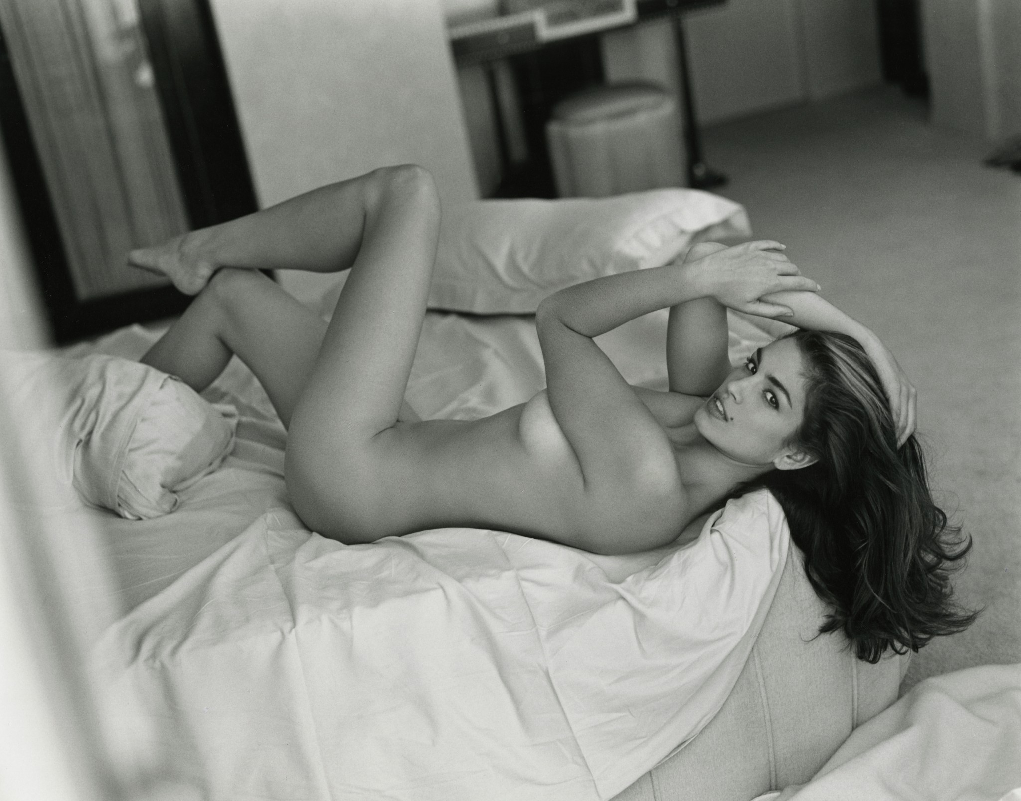 Cindy Crawford poses naked in bed for Sante D'Orazio