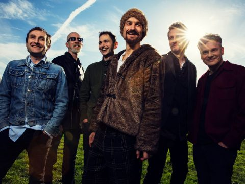 James with singer Tim Booth (centre)
