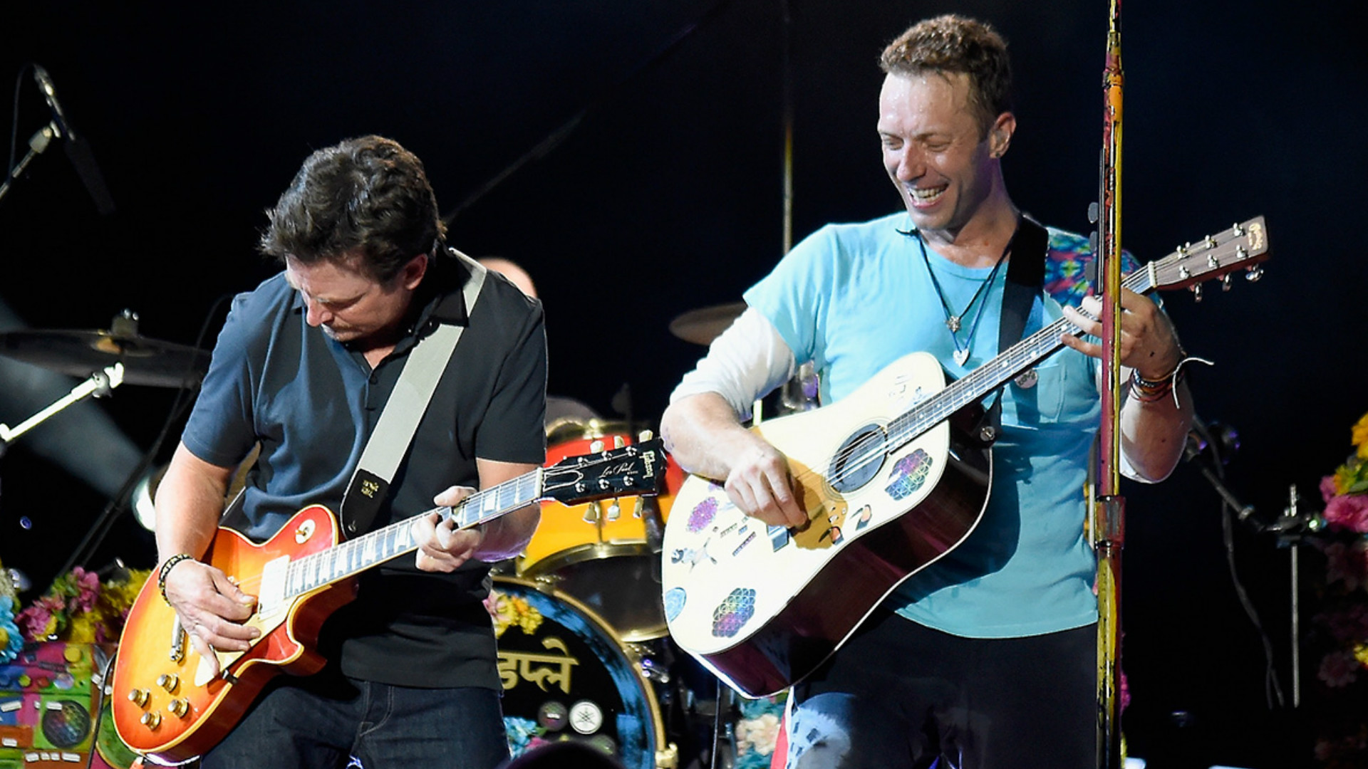 Michael J Fox and Chris Martin perform Johnny B Goode