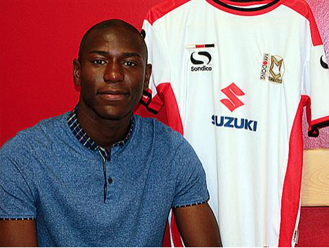 Benik Afobe signs for MK Dons on loan.