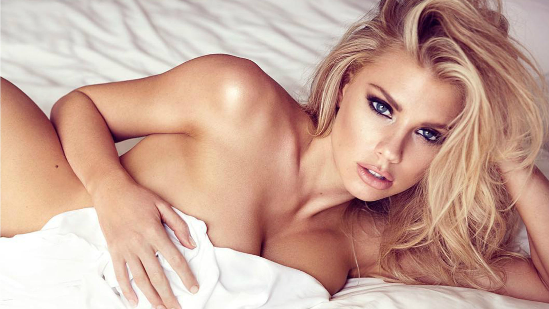 Charlotte McKinney naked in bed