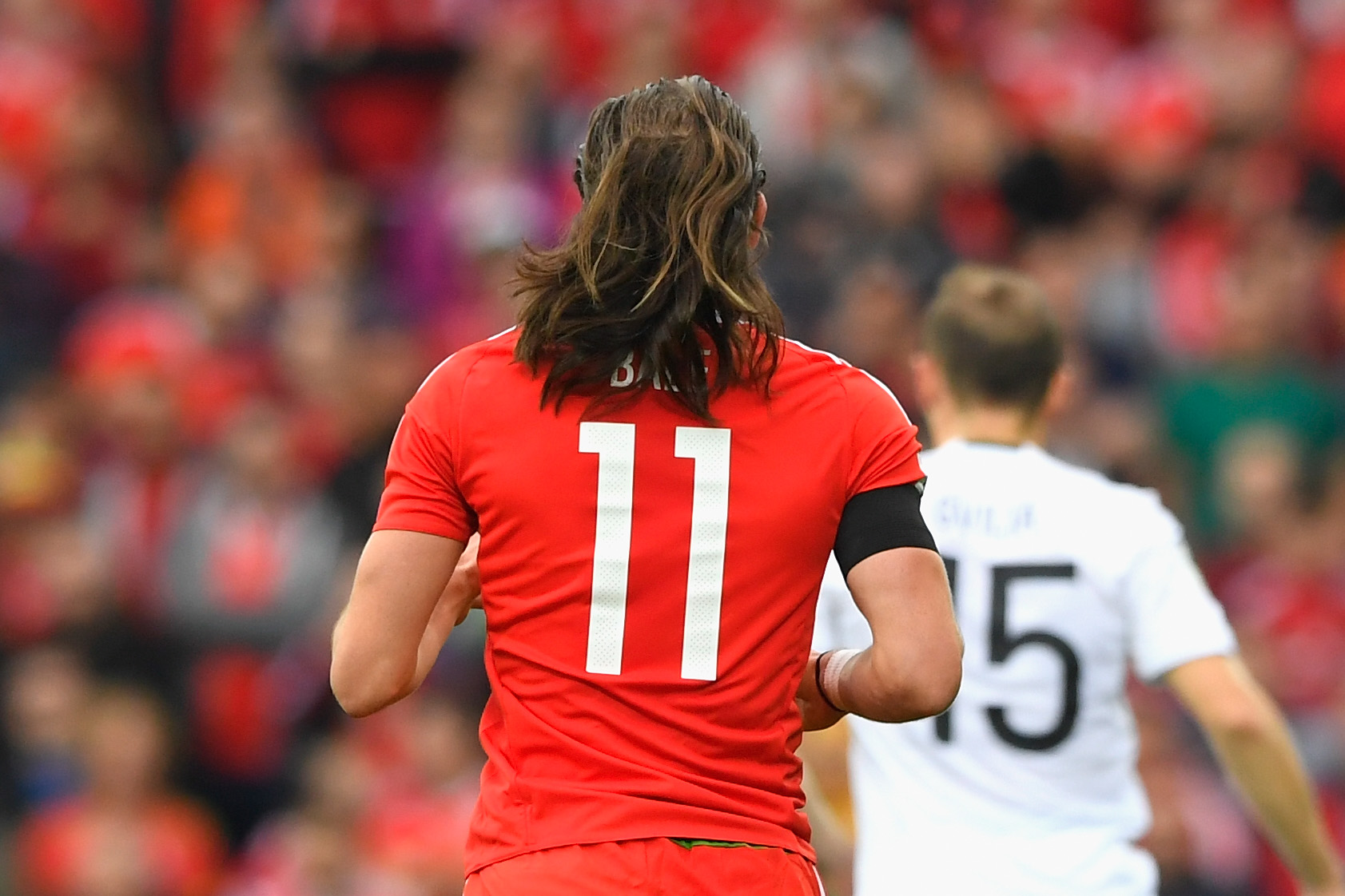 Gareth Bale lets his hair down for Wales.