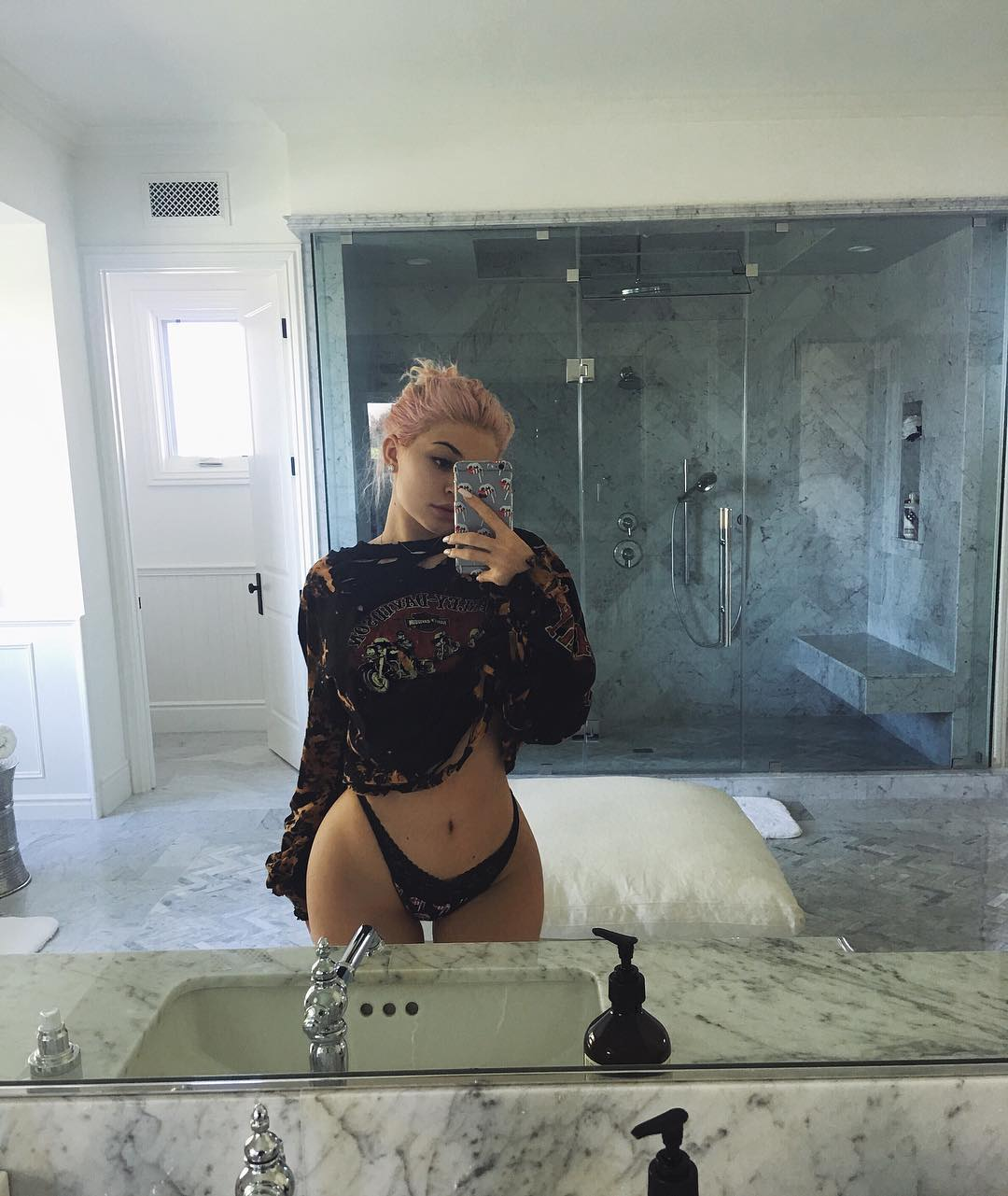 Kylie Jenner poses in her panties.
