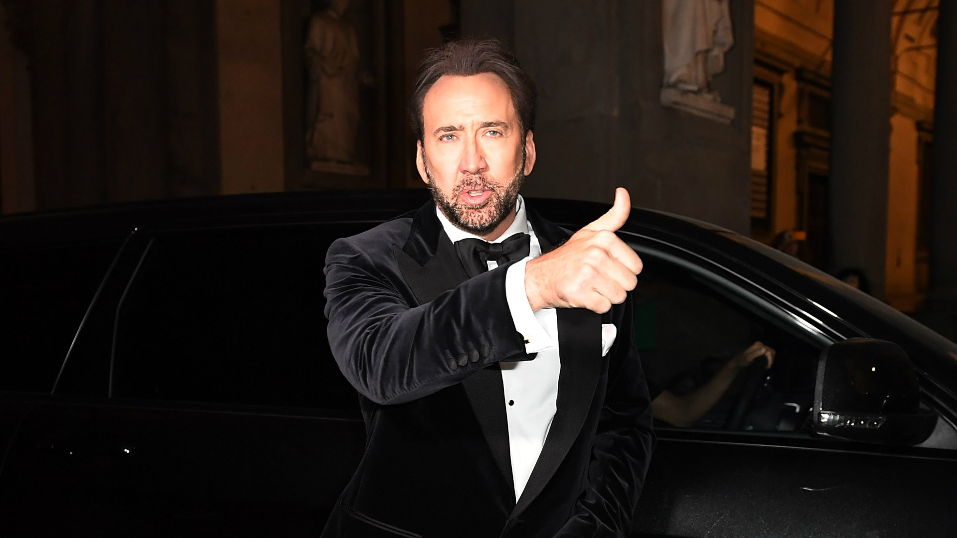 Nicolas Cage getting out of a car.