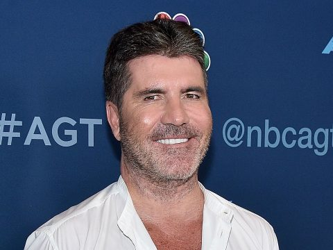 Simon Cowell posing on a red carpet.