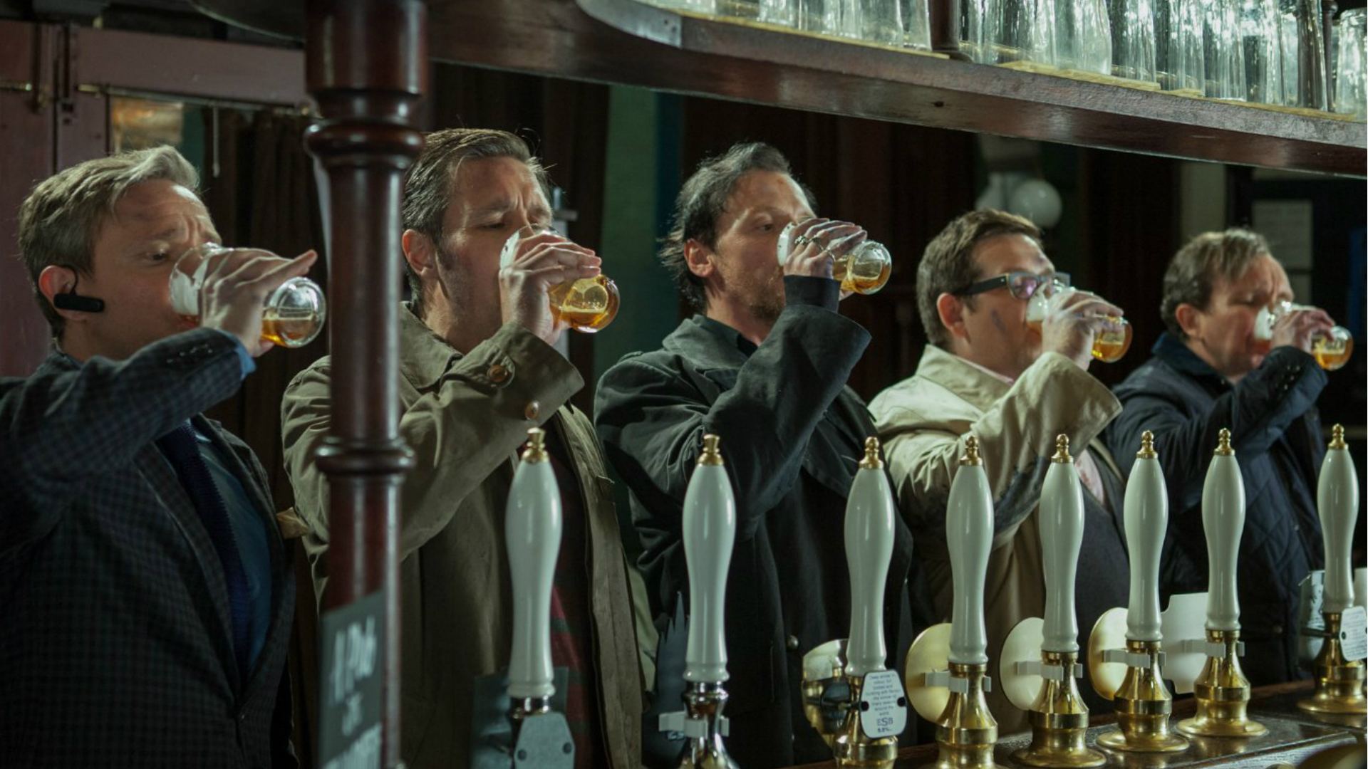 The cast of World's End downing pints of beer