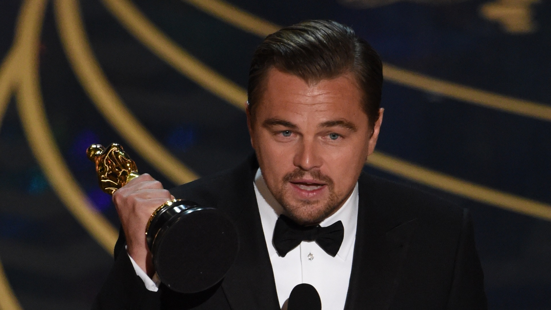 Actor Leonardo DiCaprio accepts the award for Best Actor in,The Revenant on stage at the 88th Oscars on February 28, 2016 in Hollywood, California. AFP PHOTO / MARK RALSTON / AFP / MARK RALSTON (Photo credit should read MARK RALSTON/AFP/Getty Images)