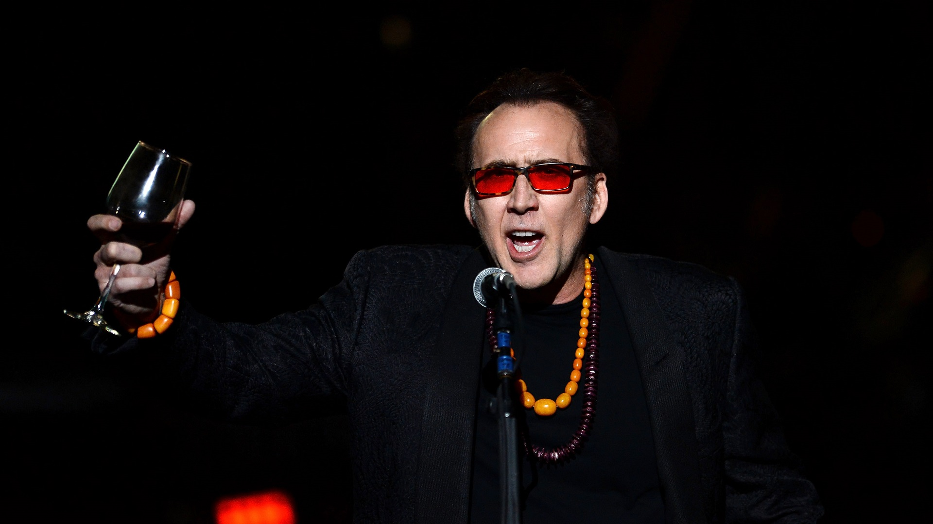 "LAS VEGAS, NV - MAY 21: Actor Nicolas Cage introduces Guns N' Roses at The Joint inside the Hard Rock Hotel & Casino during the opening night of the band's second residency, ""Guns N' Roses - An Evening of Destruction. No Trickery!"" on May 21, 2014 in Las Vegas, Nevada. (Photo by Ethan Miller/Getty Images)"