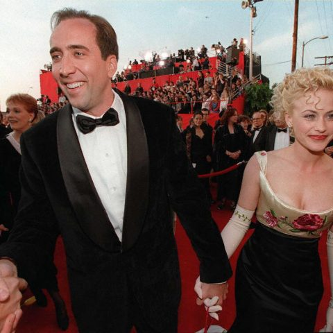 LOS ANGELES, UNITED STATES: US actor Nicolas Cage arrives at the 69th Academy Awards ceremony with his wife Patricia Arquette at the Shrine Auditorium in Los Angeles, 24 March. AFP PHOTO Hector MATA (Photo credit should read HECTOR MATA/AFP/Getty Images)