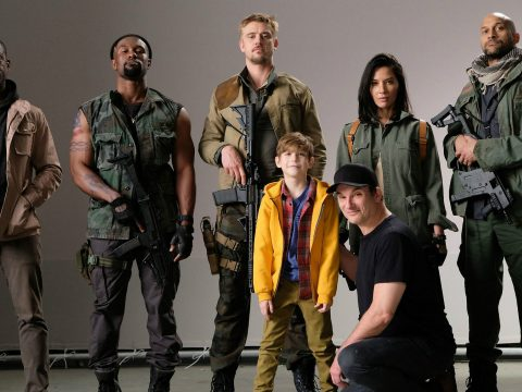 Shane Black along with the cast of The Predator.