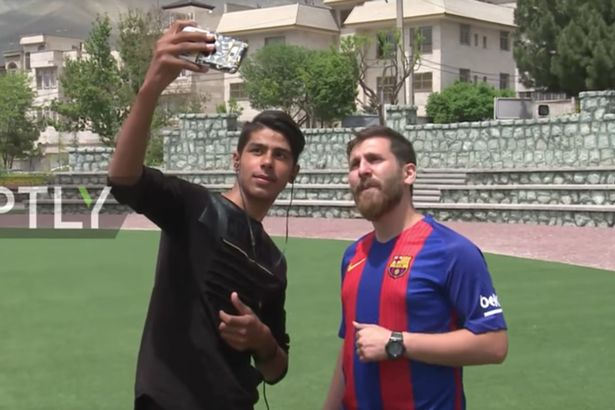 The Lionel Messi lookalike with a fan