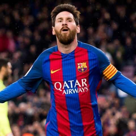 Lionel Messi celebrates for Barcelona.